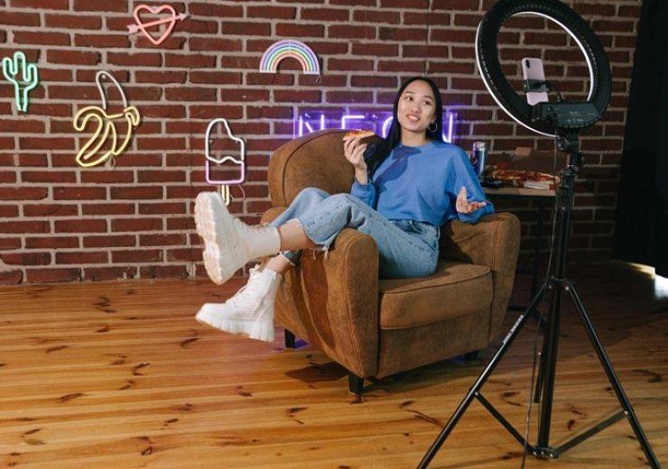 girl recording tiktok video